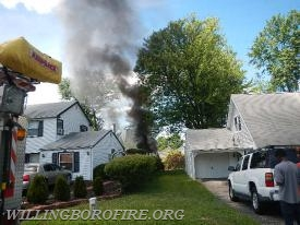 Heavy smoke coming from the rear of the home