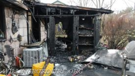 Fire damage to the rear enclosed porch