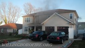 Engine 1613's crew enters the home