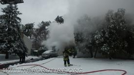 Firefighters start working on extinguishing the fire