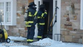 Firefighters Priest and Centrone prepare to enter the home