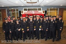 The members of the fire department with the Deputy Chief after his retirement ceremony