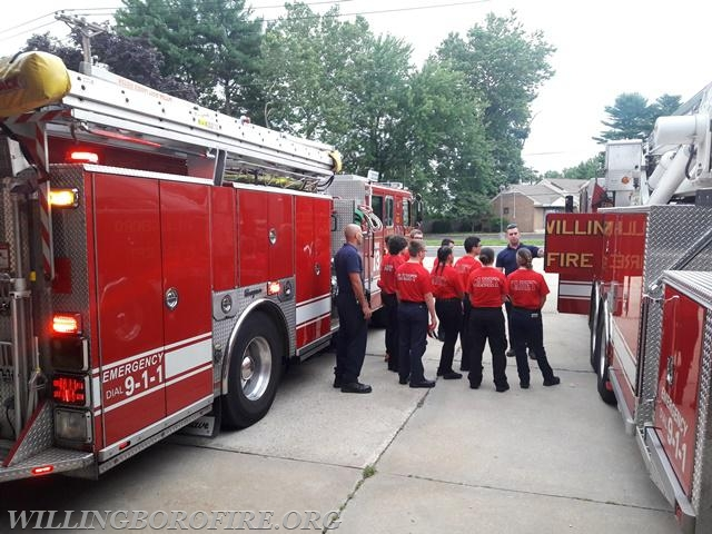 Firefighter Riley goes over the equipment of Ladder 1615 with the cadets