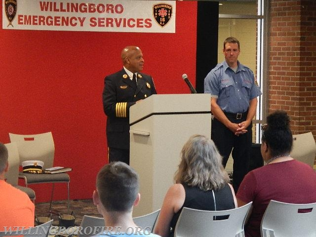 Chief of Department Burnett addresses those in attendance at the Youth Fire Academy graduation