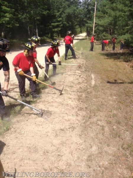 NJ Forestry Service personnel show the cadets how to create a fire break
