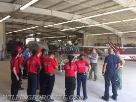 The cadets hearing about the different types of aerial firefighter apparatus used by the NJ Forestry Service