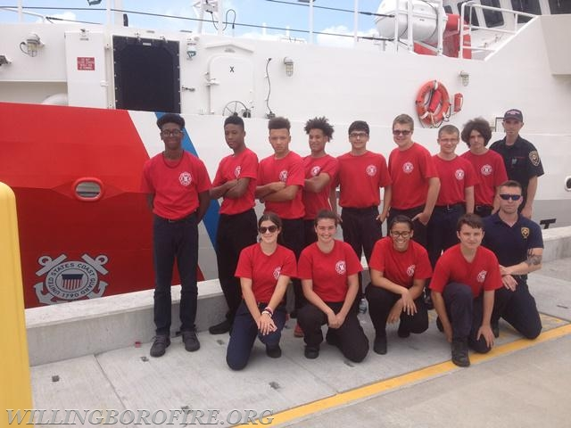 Staff and cadets in front of the USCG Cutter Rollin Fritch