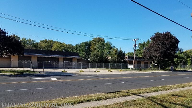 Security fencing surrounds the old building at Charleston Road and JFK Way