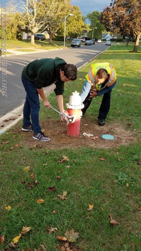 Ryan and Lieutenant Friddell complete the installation of markers on the first hydrant