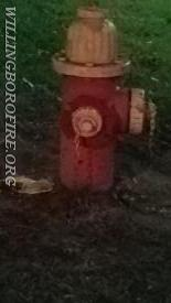 A dark hydrant with no light on the marker
