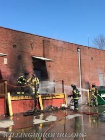Firefighters removing cardboard from the loading dock