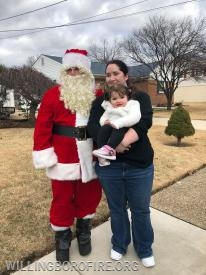 Heather and her daughter with Santa