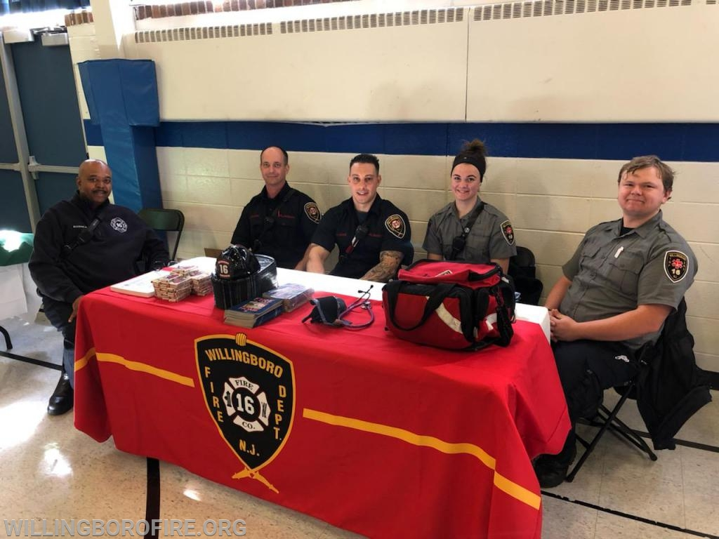 Fire police officer Boisseau, Firefighters Carcasio and Centrone, and EMTs D'Amico and Wood at the Garfield Park Academy Health Fair