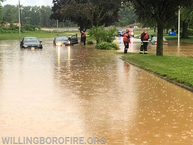 Several vehicles stranded in high water on VanSciver Parkway