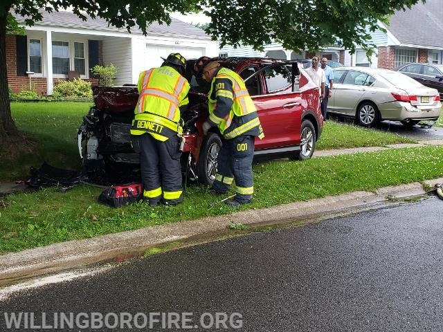 Firefighter Bennett and Lieutenant Ferrell disconnect the battery on the second vehicle