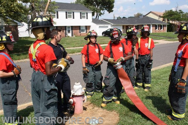 """Firefighter Riley goes over connecting a 5"""" supply hose to a fire hydrant"""