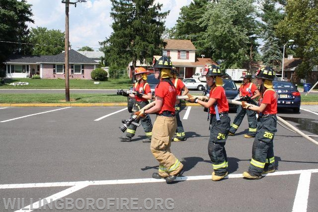 """Two crews moving 1 3/4"""" hoselines"""