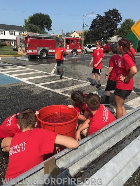 The cadets competing in the bucket brigade