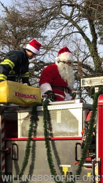 Santa in Hawthorne Park with Firefighter Rosario