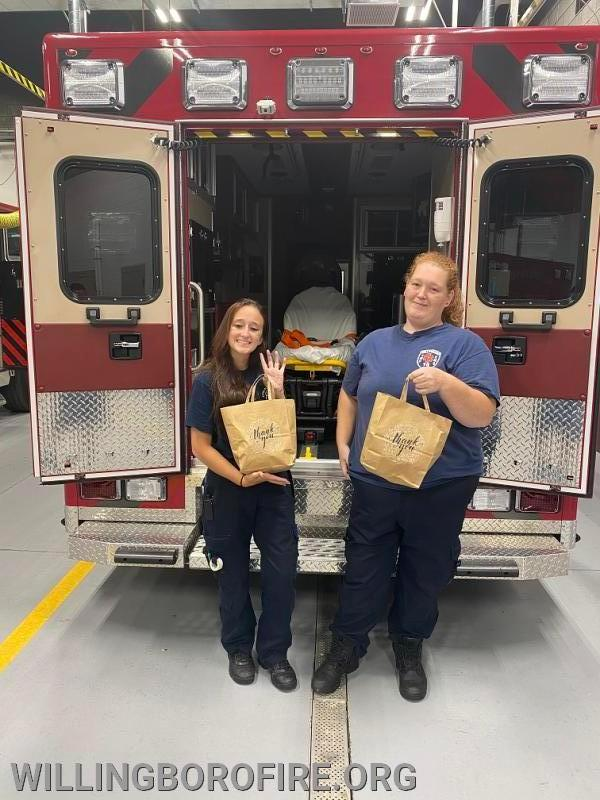 EMT Jessica Kajkowski and EMT Stephanie Blair accepting the donations.