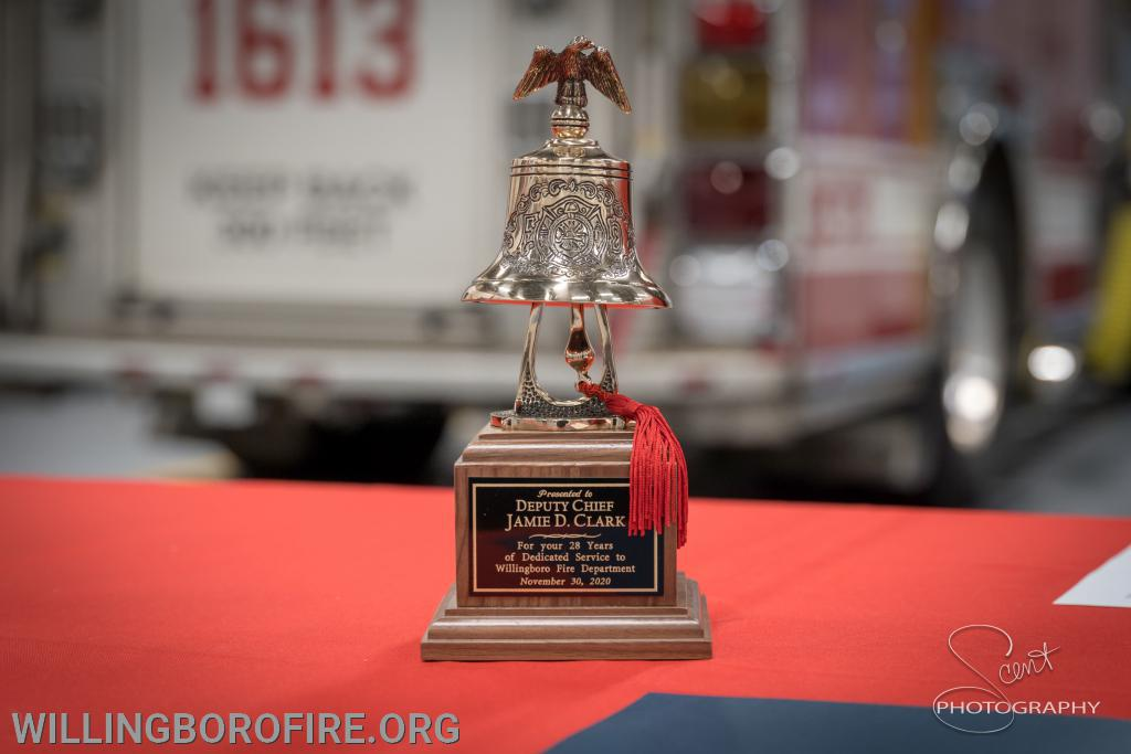 Engraved Fire Bell Award for DC Clark 28 years of dedicated service.