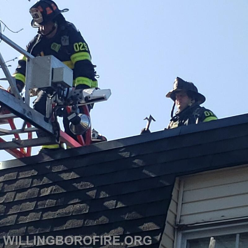Lt. Costello and FF E. O'Donnell using a ladder to enter the roof