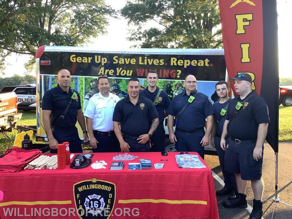 Fire department members at the table for National Night Out 2021.