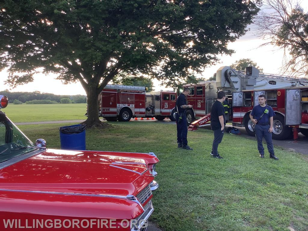 Firefighters with trucks on display and Willingboro Emergency Services Ambulance
