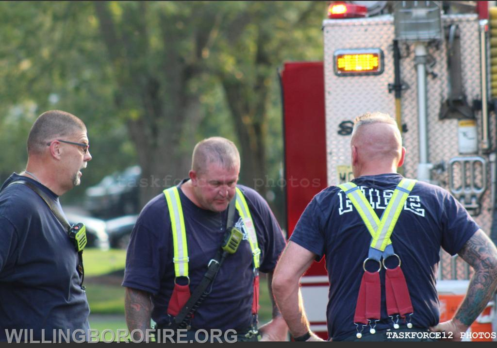(left) FF. M. Robertson, FF. E. O'Donnell, FF. D. O'Donnell speaking after coming outside of the house.