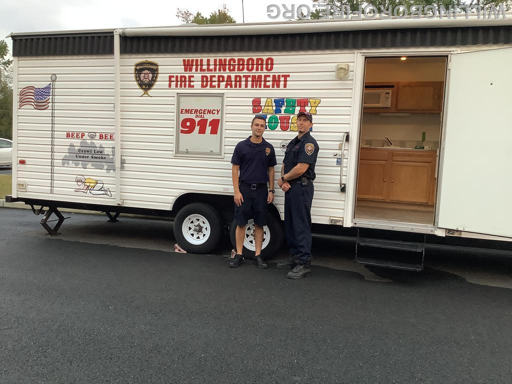 Fire Prevention trailer teaching kids to crawl and stay low if there is a fire.